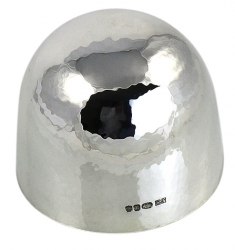 an upside down silver tumbler cup where you can see the detailed hammer marks