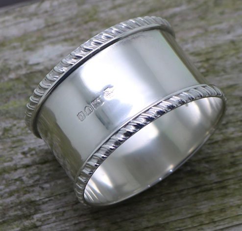 showing the highly polished silver on the silver napkin ring